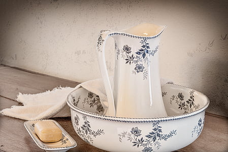 white ceramic wash basin with tray