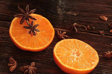 sliced orange fruit on table