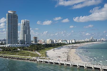 aerial photography of white bridge near beach shore