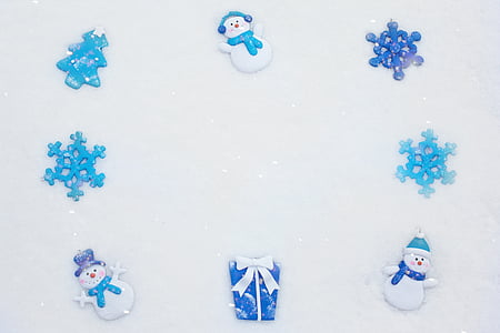 eight blue and white snowflakes and snowman Christmas decor