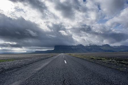 gray concrete asphalt road between desert