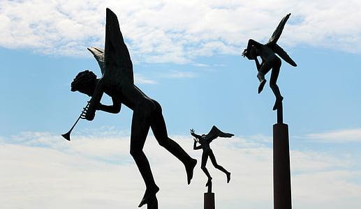 three angels statues