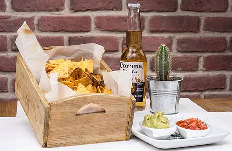 rectangular brown wooden crate beside Corona Extra beer bottle