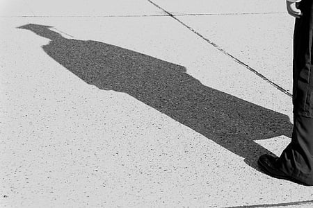 shadow of person wearing mortar hat
