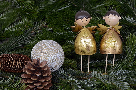 two gold Christmas decorations