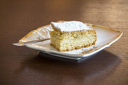 slice of cake on white ceramic plate