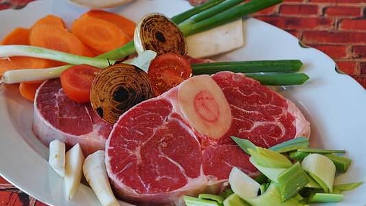raw meat with spring onions and sliced carrots