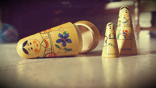 three beige nesting dolls