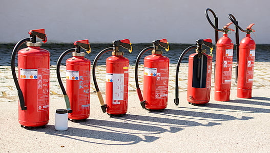 seven fire extinguisher on seashore