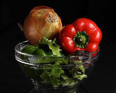 onion and chili pepper on clear glass bowl