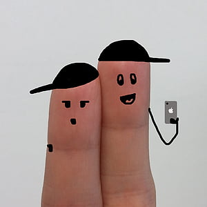 two person's fingers