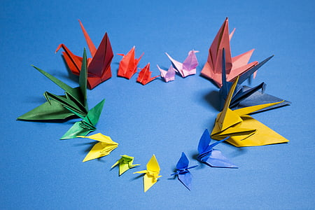 assorted-color bird origami on blue surface