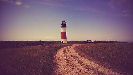 photo of lighthouse near pathway