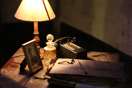 table lamp beside photo frame on table