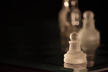 white wooden chess part
