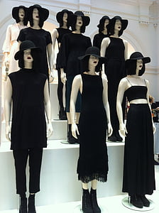 female mannequins dressed with black clothings