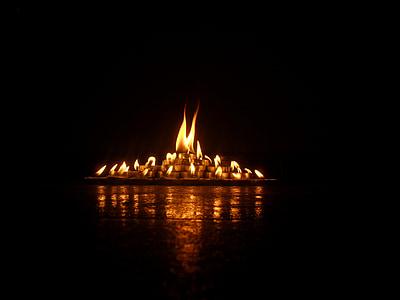 lighted candle inside dark room