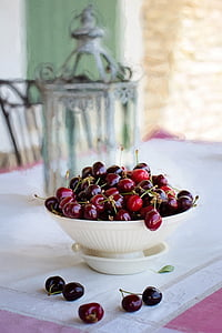 bowl of red and black grapes
