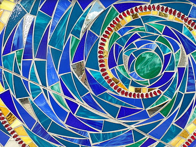 blue, yellow, and green spiral wallpaper