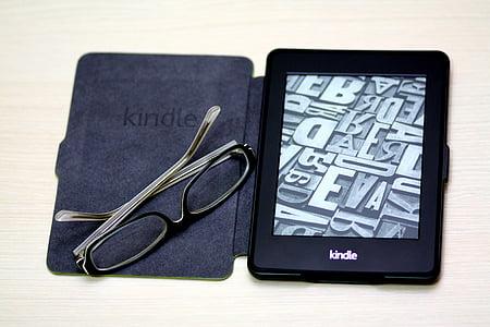 turned on black Amazon Kindle e-reader