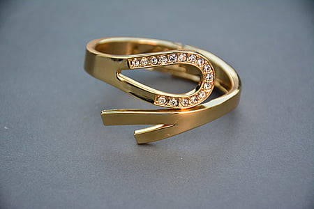 gold-colored ring with clear gemstones