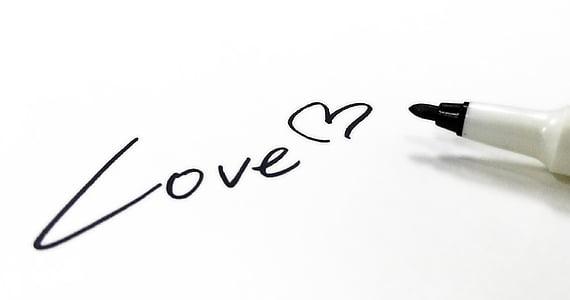 love handwritten text near black marker