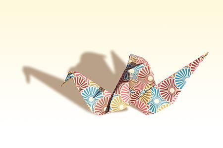 multicolored origami swan