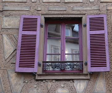 purple wooden window open