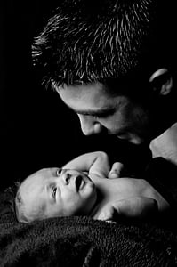 grayscale photo of man facing baby photo