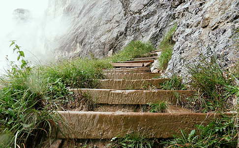 brown stone staircase on side of mountain during daytime
