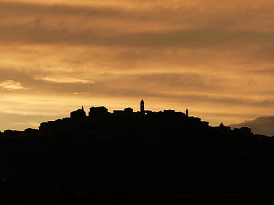 silhouette photo of buildings during golden hour