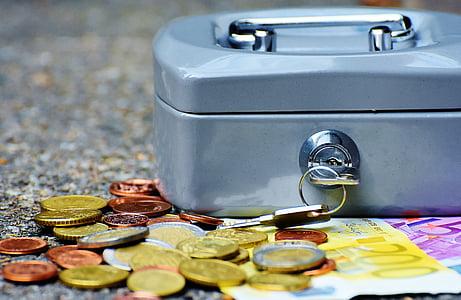 closeup photo of coins near case