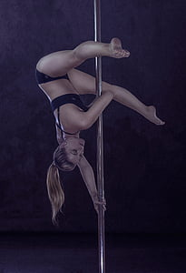 woman dancing on pole