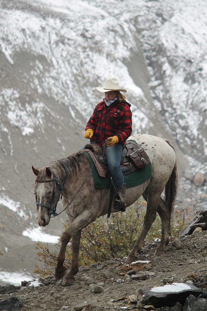 woman riding white horse