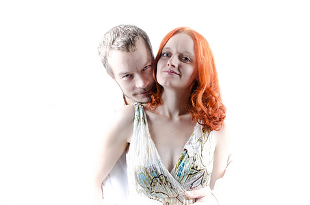 man embracing woman with white background