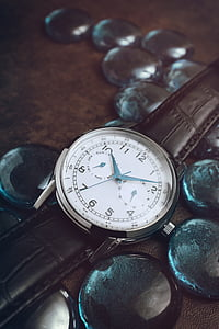 round silver-colored analog watch at 10:09