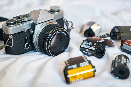 gray and black filmed camera with film cartridges