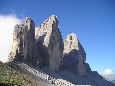 gray rocky formation under blue sky