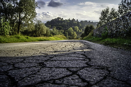 gray asphalt road with crack