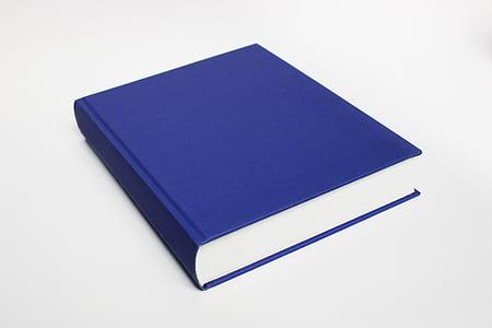blue soft-bound book