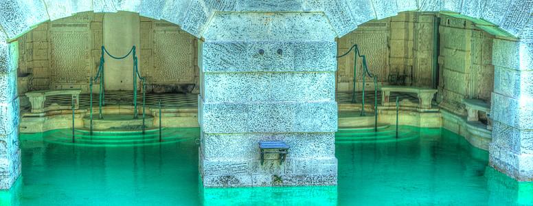 pool under gray concrete building