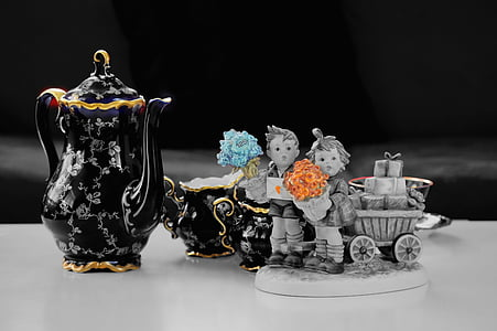 close up photo of figurines and tea set