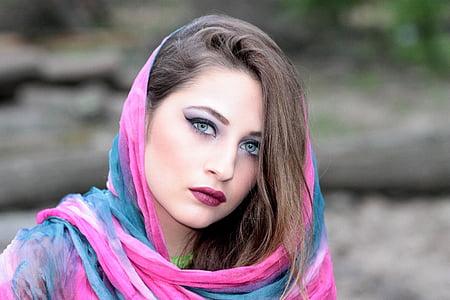 woman wearing pink and blue hijab headdress