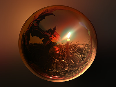 lighted candle inside glass ball