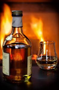 closeup photo of clear glass liquor bottle