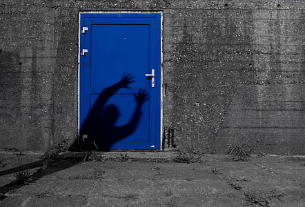 person's shadow on door