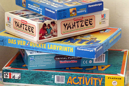 stack of assorted-brand board game boxes
