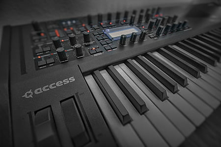 black and gray Acess electronic keyboard