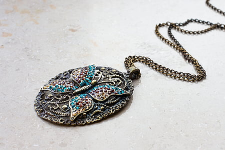 oval gold-colored blue butterfly pendant necklace