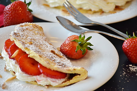white flat bread with strawberries on top of white plate